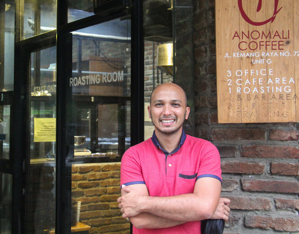 Irvan Helmi, founder of Anomali Coffee, stands outside his South Jakarta shop, which specializes in single-source coffees from around the Indonesian archipelago. (Photo Credit: Yosef Riadi for NPR)
