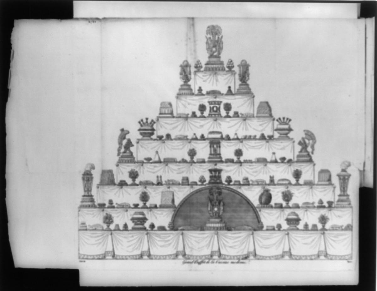 Carême shaped confections like different foods, helmets, Turkish mosques and Greek temples, among other things, on this 8-layer cake illustrated circa 1822. (Photo Credit: Library of Congress)