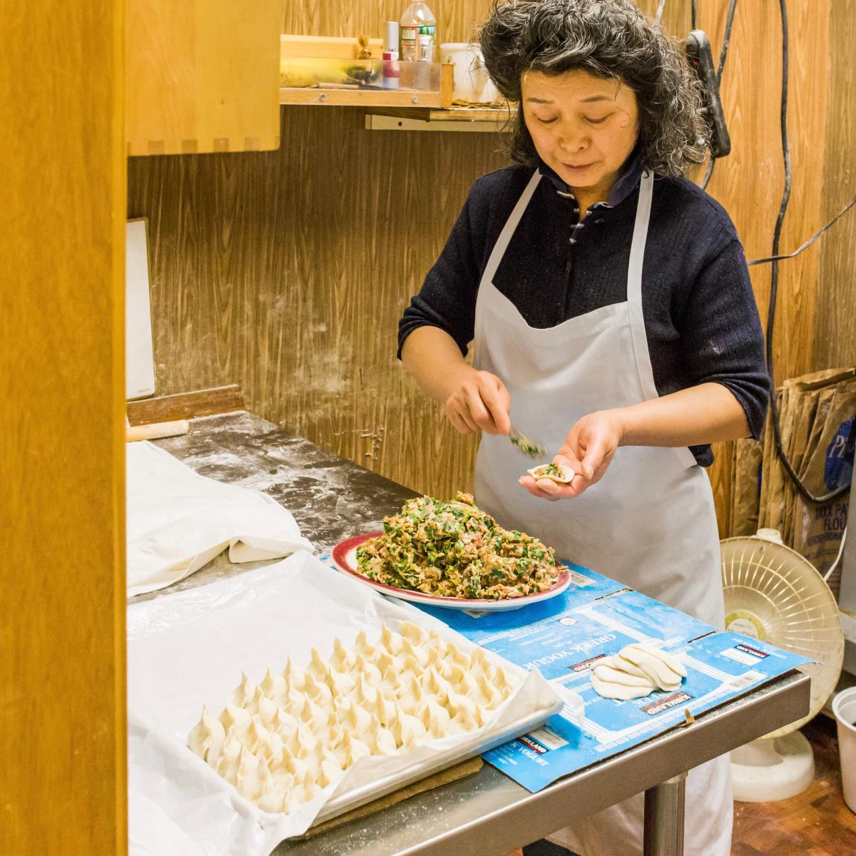 dumpling lady jianhua ma makes qingdao gardens famous pork and leek dumplings by hand photo nicole fleming - Qingdao Garden