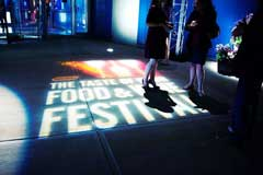 Projection of Food and Wine Festival logo on floor