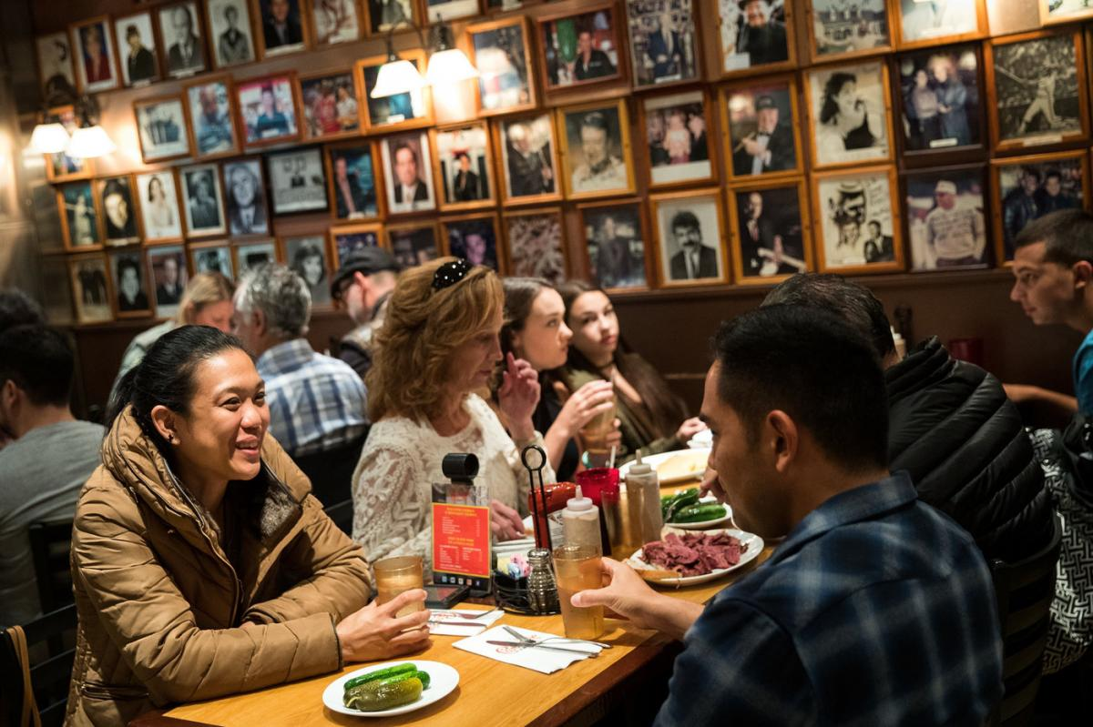 Customers dine at Carnegie Deli in New York City. The iconic deli, known for its large pastrami and corned beef sandwiches, announced it will close at the end of the year. (Photo: Drew Angerer/Getty Images)