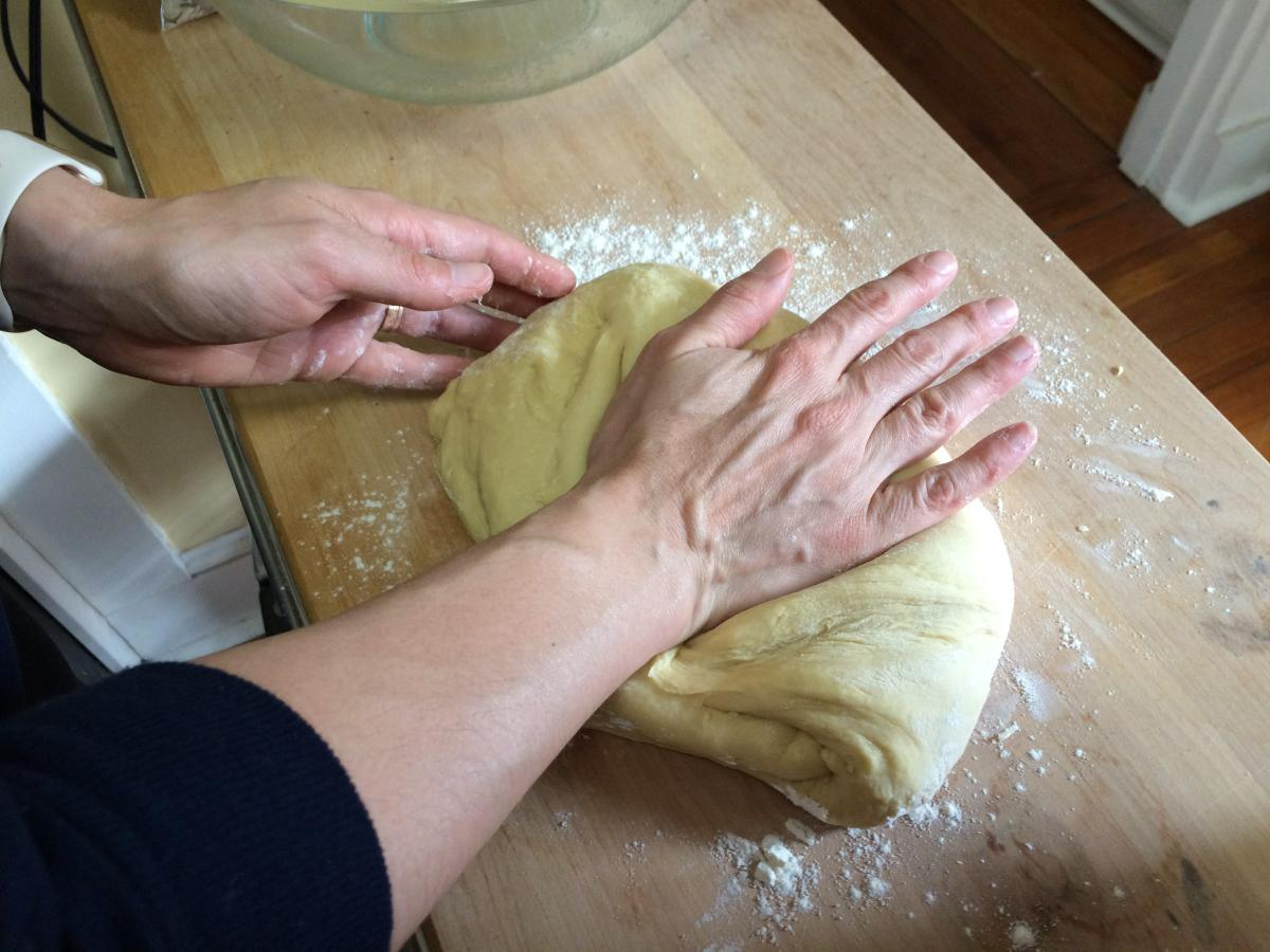 Knead the dough briefly on a lightly floured surface before shaping it for its second rise. (Photo: Danielle DeSiato)