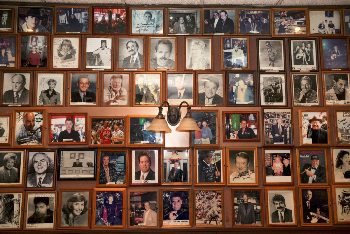 Pictures of movie stars and famous people who have dined at the deli hang on the restaurant's wall. (Photo: Courtesy of Carnegie Deli)