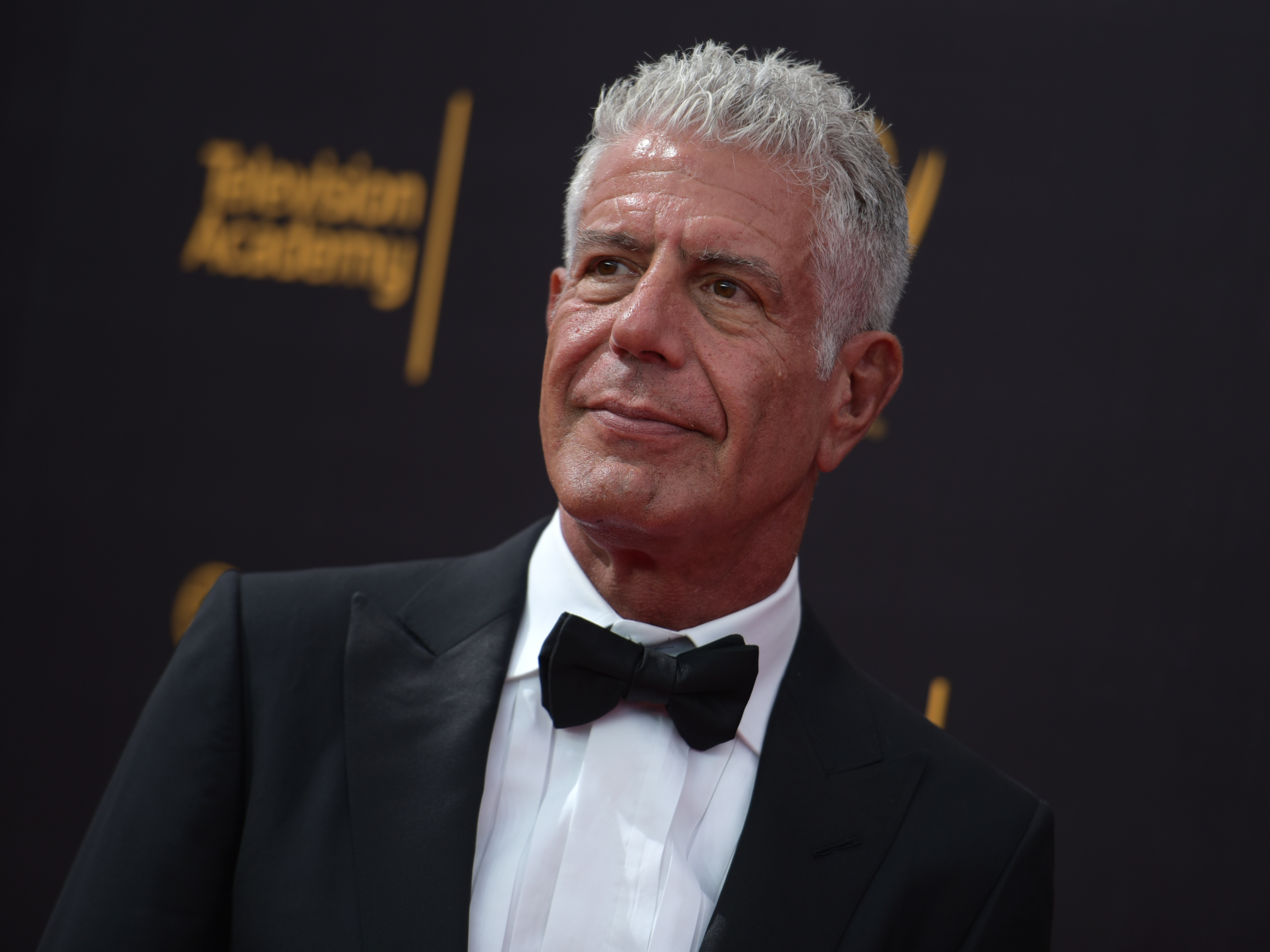 Anthony Bourdain arrives at the Microsoft Theater in Los Angeles on Sunday, Sept. 11, 2016.