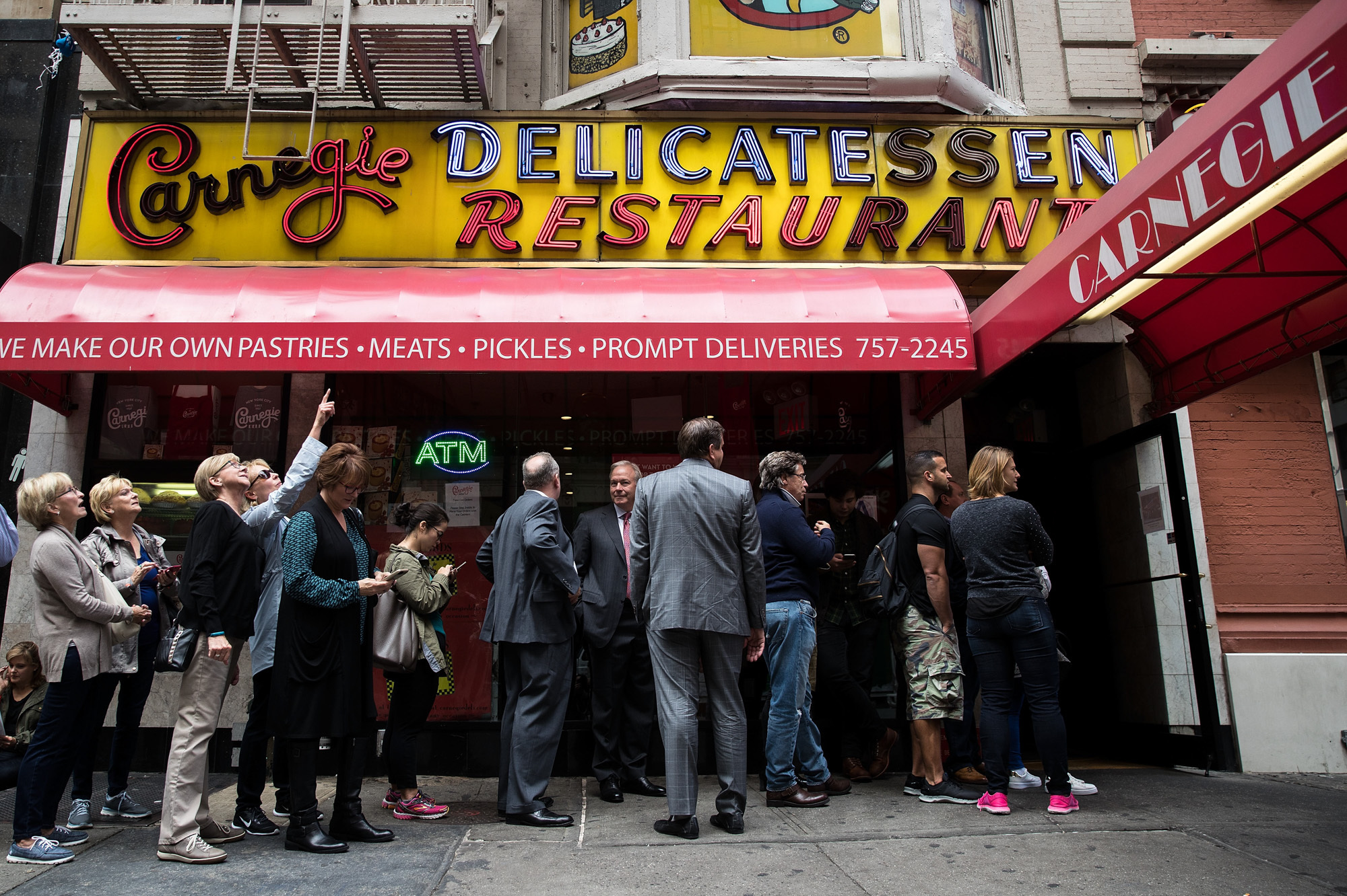 Customers wait in line outside for a table at the Carnegie Deli. (Photo: Drew Angerer/Getty Images)