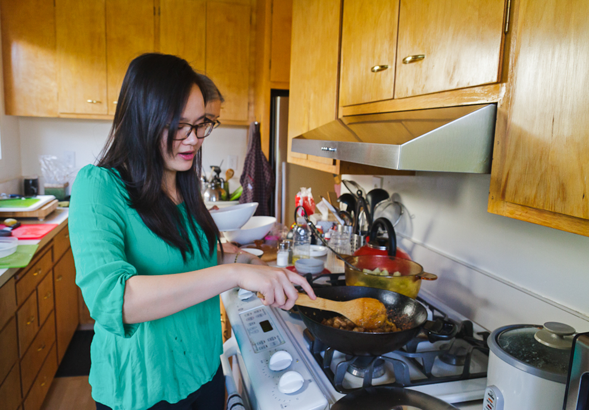 Khanh-Hoa Nguyen cooks caramelized pork belly with ginger, a Cambodian dish served to women who have just given birth. (Photo Courtesy: Grace Hwang Lynch for NPR)