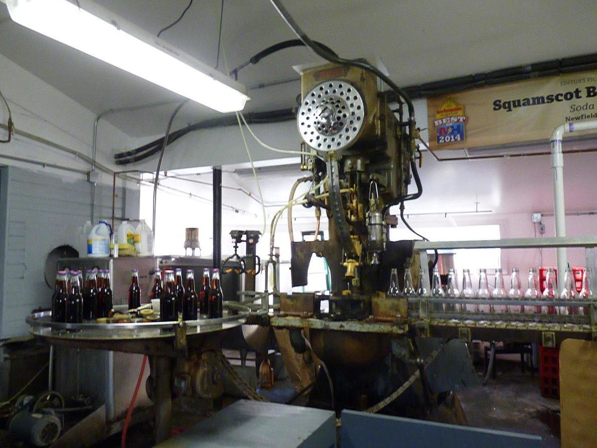 "The ""Dixie,"" purchased from a Baltimore supplier in 1938 for $2,400, is still the only bottler Squamscot uses. (Photo Credit: Tom Bookman/New Hampshire Public Radio)"