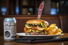 """The """"crunchy burger"""" at The Fix Burger Bar in Worcester packs — what else? — all things crunchy: potato chips, fried prosciutto, parmesan crisps, lettuce, mustard pickles, and garlic mayo. (Photo: Erb Photography)"""
