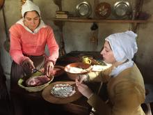 Talk about scratch cooking! Women at Plimoth Plantation work on homemade sausages for their lunch. (Photo: Amanda Balagur)
