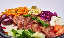Beef is spiced then seared on a grill, delicious on salad greens with toppings like pickled red cabbage and carrot slaw with golden raisins. (Photo: courtesy of Renita Mendonca)